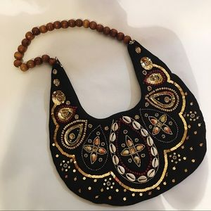 Shoulder Bag from India sequence, beads shells